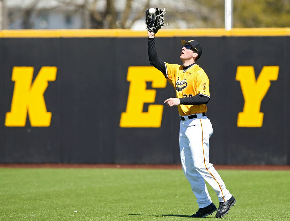 Iowa Hawkeyes right fielder Connor McCaffery (30) pulls in a fly ball for an out during the second inning against Illinois at Duane Banks Field in Iowa City on Sunday, Mar. 31, 2019. (Stephen Mally/hawkeyesports.com)