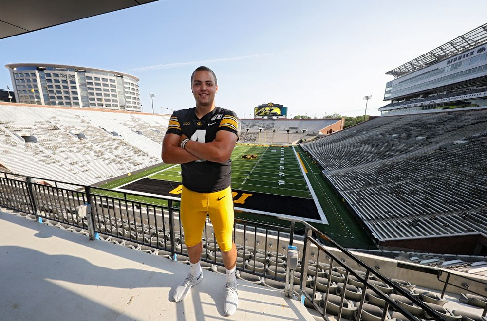 Iowa Hawkeyes quarterback Nate Stanley (4) stands in the Kinnick Edge Outdoor Club at Kinnick Stadium in Iowa City on Friday, Aug 9, 2019. (Stephen Mally/hawkeyesports.com)