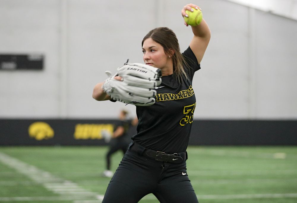 Iowa outfielder Riley Sheehy (33) warms up for practice during Iowa Softball Media Day at the Hawkeye Tennis and Recreation Complex in Iowa City on Thursday, January 30, 2020. (Stephen Mally/hawkeyesports.com)