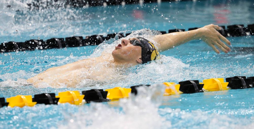 Iowa's John Colin competes in the 200-yard backstroke during a meet against Michigan and Denver at the Campus Recreation and Wellness Center on November 3, 2018. (Tork Mason/hawkeyesports.com)