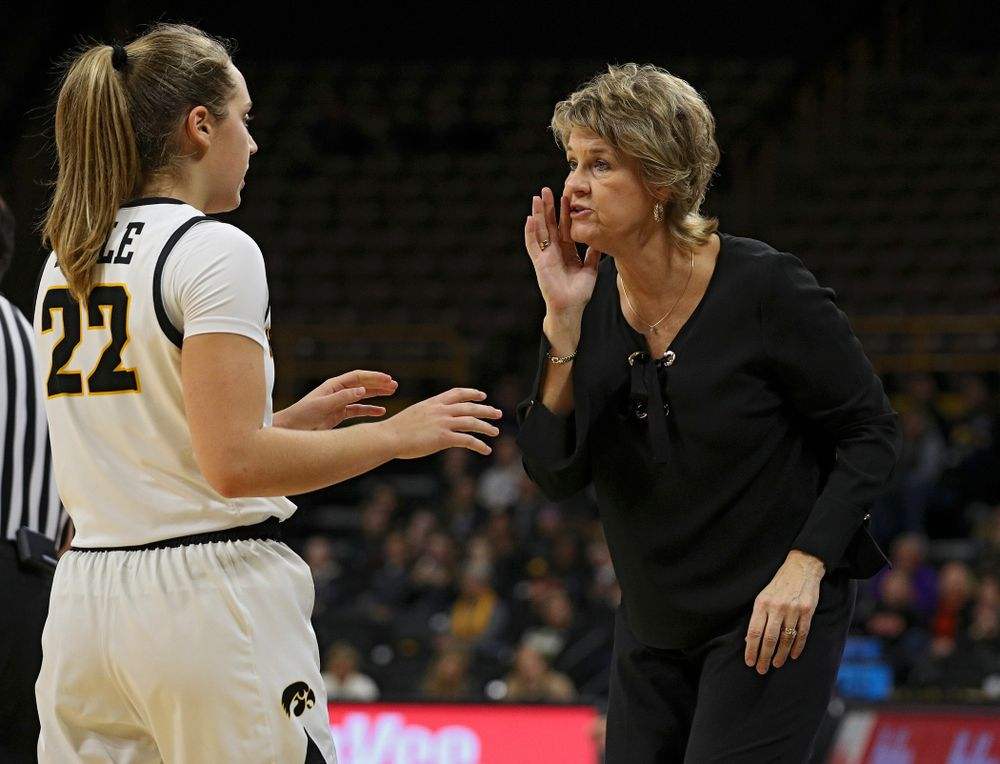 Iowa head coach Lisa Bluder (right) talks with guard Kathleen Doyle (22) during the third quarter of their overtime win against Princeton at Carver-Hawkeye Arena in Iowa City on Wednesday, Nov 20, 2019. (Stephen Mally/hawkeyesports.com)