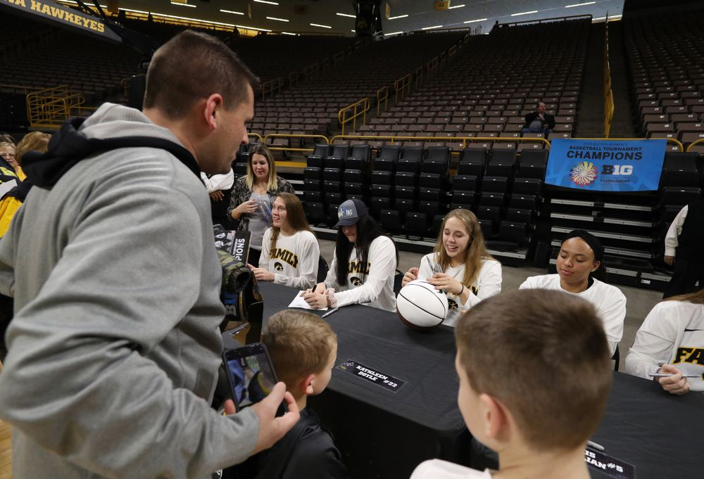 Iowa Hawkeyes guard Kathleen Doyle (22) during a celebration of their Big Ten Women's Basketball Tournament championship Monday, March 18, 2019 at Carver-Hawkeye Arena. (Brian Ray/hawkeyesports.com)