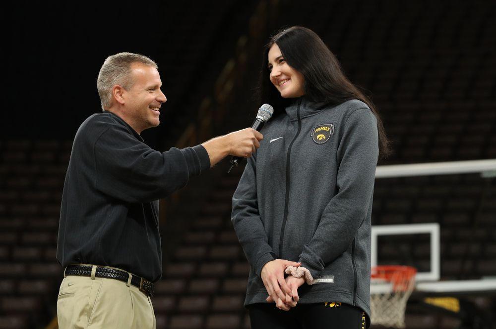 Iowa WomenÕs Basketball radio announcer Rob Books and forward Megan Gustafson (10) during the teamÕs Celebr-Eight event Wednesday, April 24, 2019 at Carver-Hawkeye Arena. (Brian Ray/hawkeyesports.com)