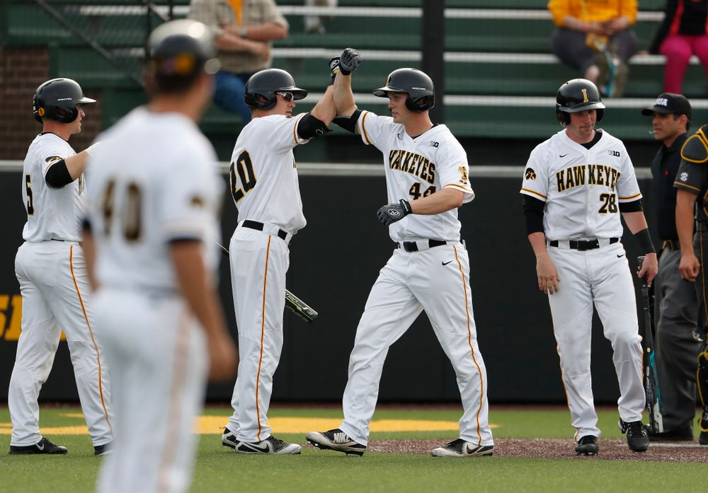 Iowa Hawkeyes outfielder Robert Neustrom (44) celebrates with catcher Austin Guzzo (20) after hitting a home run against the Missouri Tigers Tuesday, May 1, 2018 at Duane Banks Field. (Brian Ray/hawkeyesports.com)