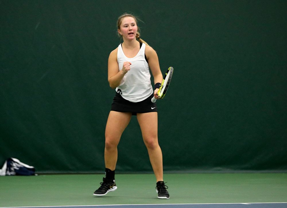 Iowa's Danielle Burich celebrates a point during her singles match at the Hawkeye Tennis and Recreation Complex in Iowa City on Sunday, February 23, 2020. (Stephen Mally/hawkeyesports.com)