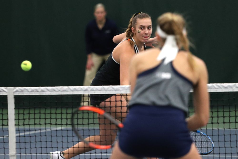 Iowa's Ashleigh Jacobs and Sophie Clark play a doubles match against the Penn State Nittany Lions Sunday, February 24, 2019 at the Hawkeye Tennis and Recreation Complex. (Brian Ray/hawkeyesports.com)