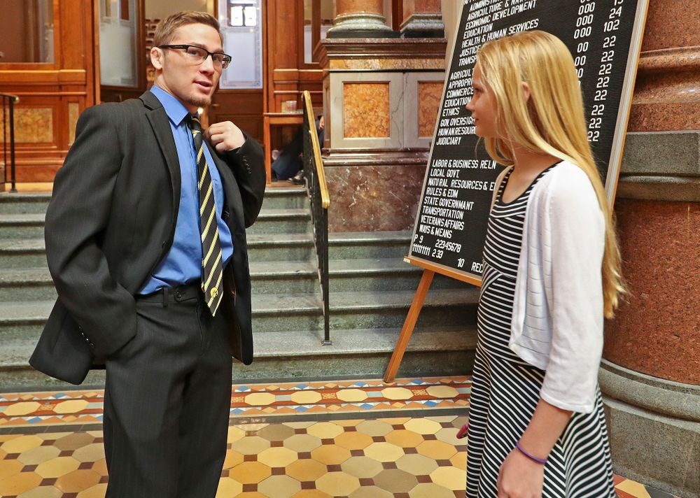 Iowa's Spencer Lee talks with a young fan at the Iowa State Capitol Building on Tuesday, Apr. 9, 2019. (Stephen Mally/hawkeyesports.com)