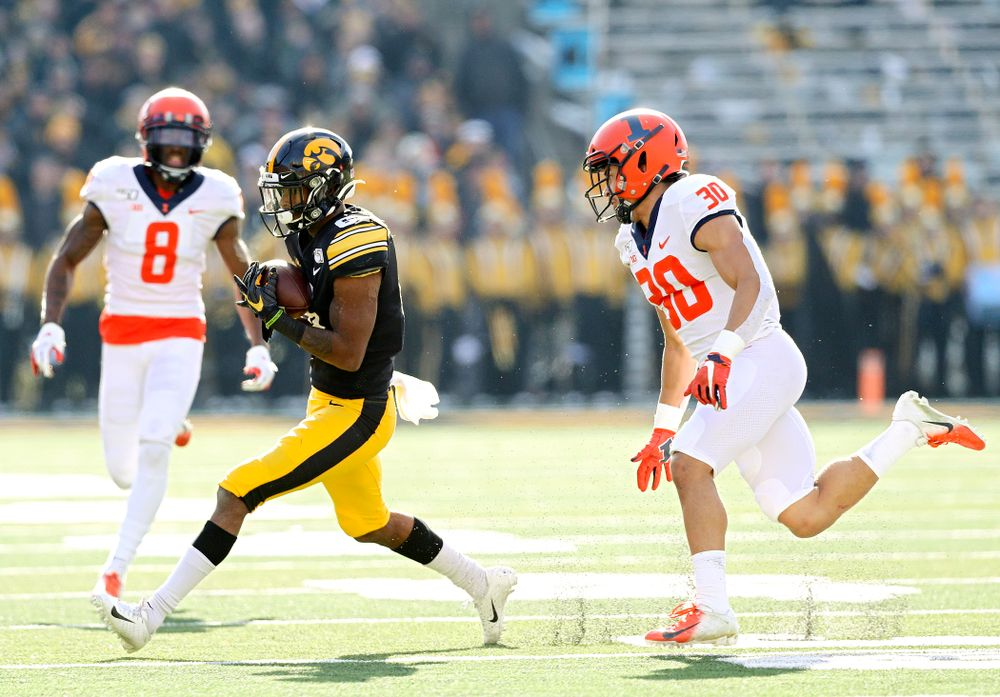 Iowa Hawkeyes wide receiver Ihmir Smith-Marsette (6) pulls in a pass during the second quarter of their game at Kinnick Stadium in Iowa City on Saturday, Nov 23, 2019. (Stephen Mally/hawkeyesports.com)