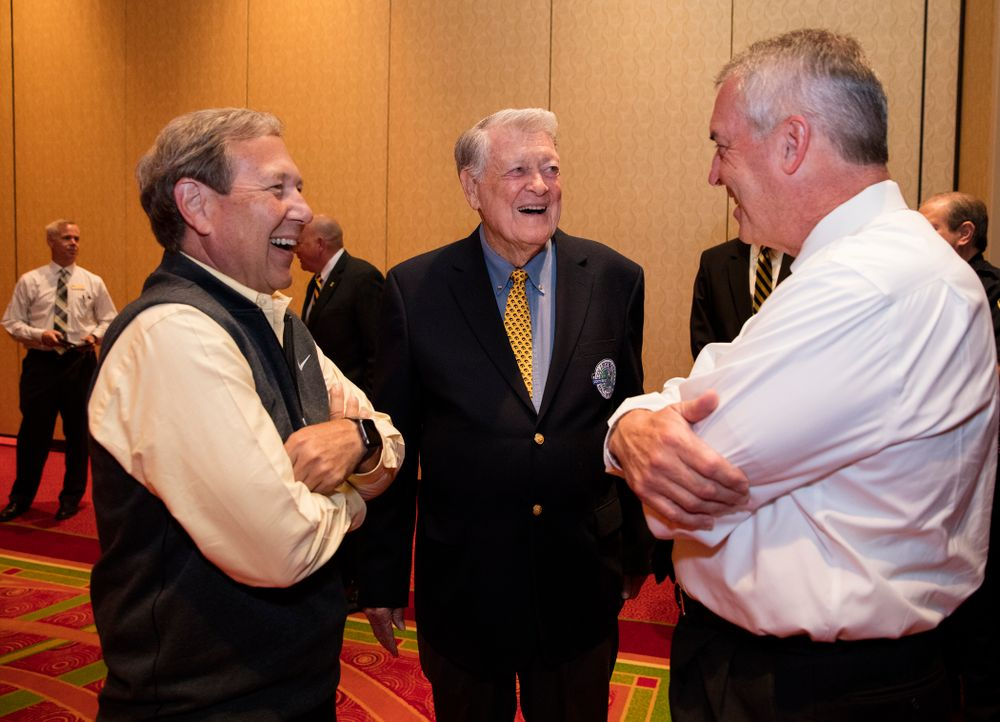Legendary Hawkeye Football Coach Hayden Fry talks with UI President Bruce Harreld and UI Director of Athletics Gary Barta before the unveiling of his statue during Fry Fest Friday, September 2, 2016 at the Coralville Marriott Hotel and Conference Center. (Brian Ray/hawkeyesports.com)