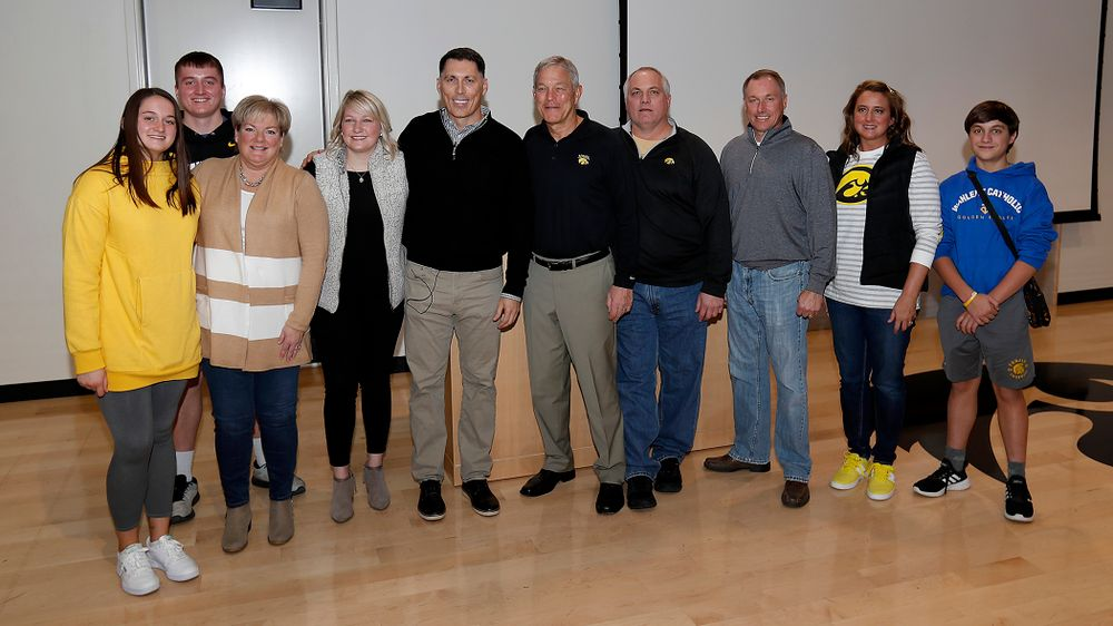 The Mike Reilly family with head coach Kirk Ferentz