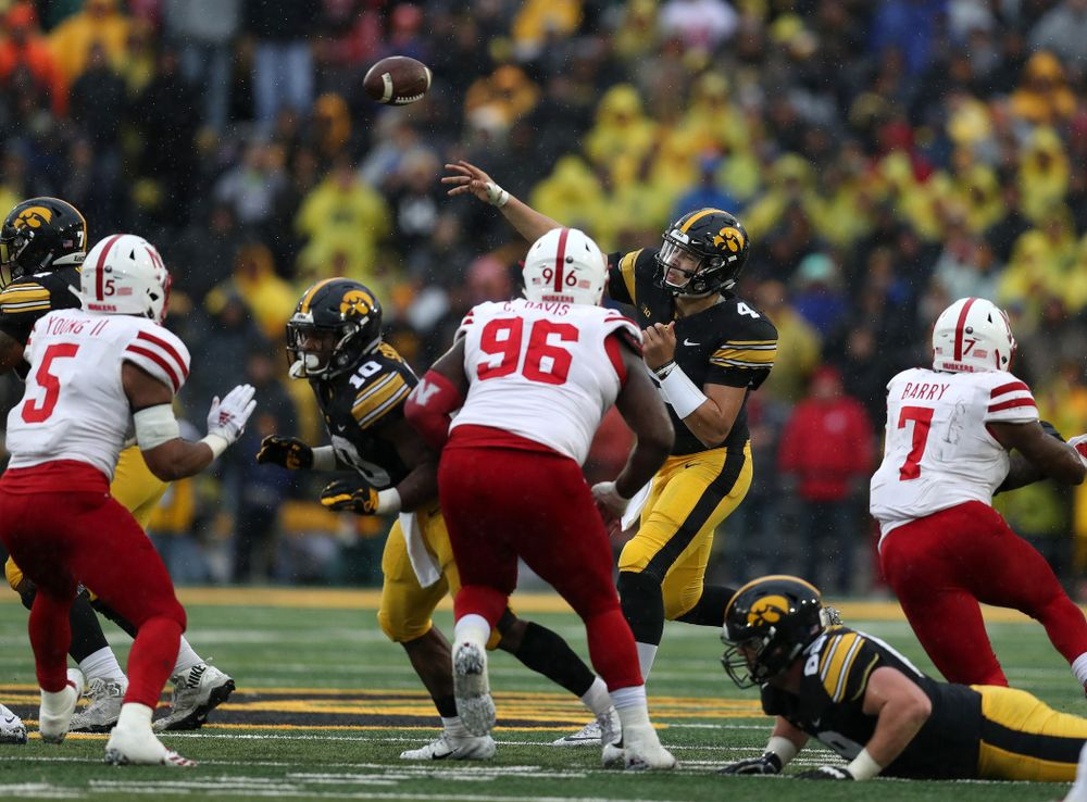 Iowa Hawkeyes quarterback Nate Stanley (4) fires the ball to tight end T.J. Hockenson (38) for a first down on fourth and eight against the Nebraska Cornhuskers Friday, November 23, 2018 at Kinnick Stadium. (Brian Ray/hawkeyesports.com)