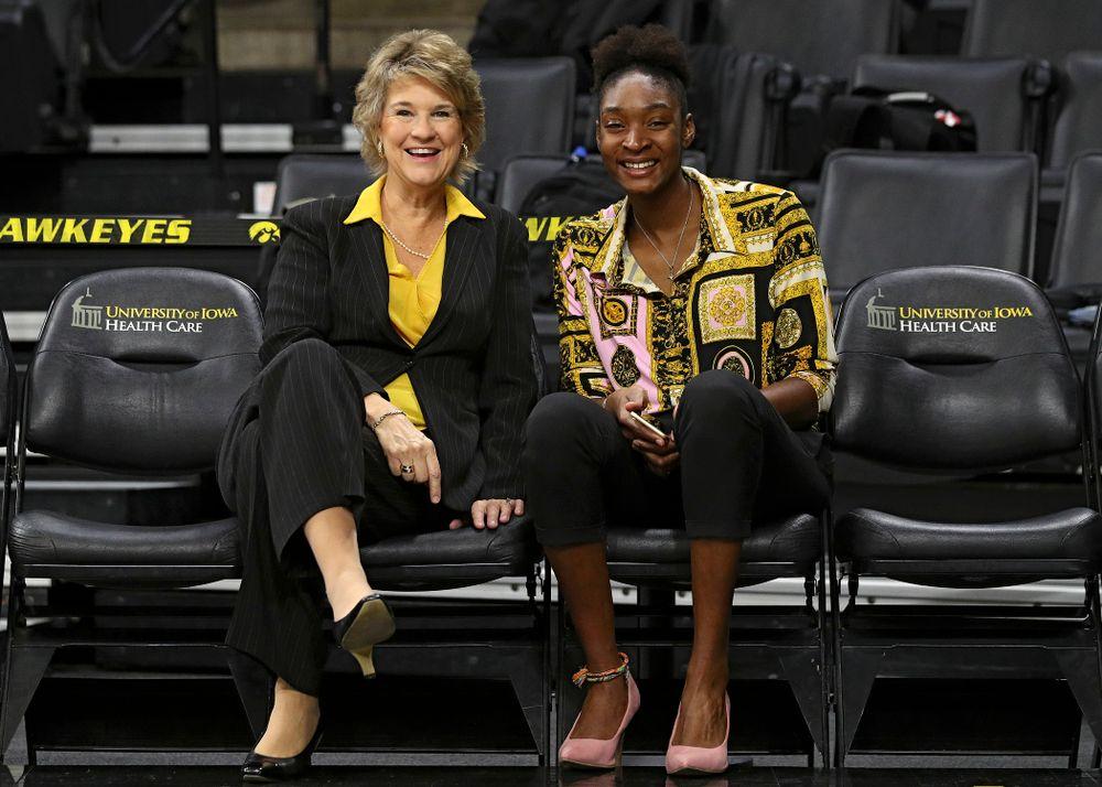 Iowa head coach Lisa Bluder and Iowa director of basketball operations Ugo Nwaigwe during Iowa Women's Basketball Media Day at Carver-Hawkeye Arena in Iowa City on Thursday, Oct 24, 2019. (Stephen Mally/hawkeyesports.com)
