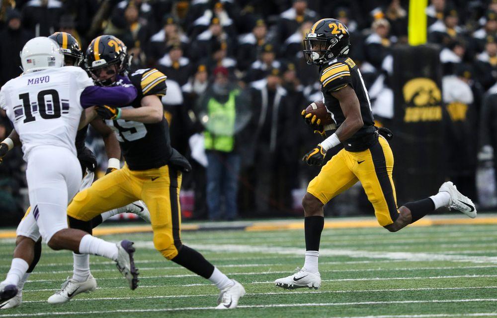 Iowa Hawkeyes wide receiver Ihmir Smith-Marsette (6) runs the ball during a game against Northwestern at Kinnick Stadium on November 10, 2018. (Tork Mason/hawkeyesports.com)