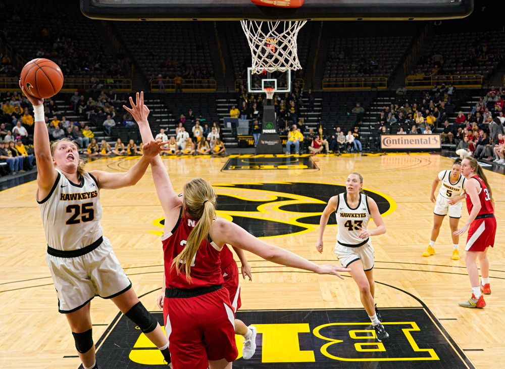 Iowa Hawkeyes forward Monika Czinano (25) makes a basket during the third quarter of the game at Carver-Hawkeye Arena in Iowa City on Thursday, February 6, 2020. (Stephen Mally/hawkeyesports.com)