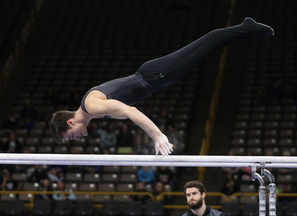 Iowa's Mitch Mandozzi competes on the parallel bars against the Ohio State Buckeyes  Saturday, March 16, 2019 at Carver-Hawkeye Arena.  (Brian Ray/hawkeyesports.com)