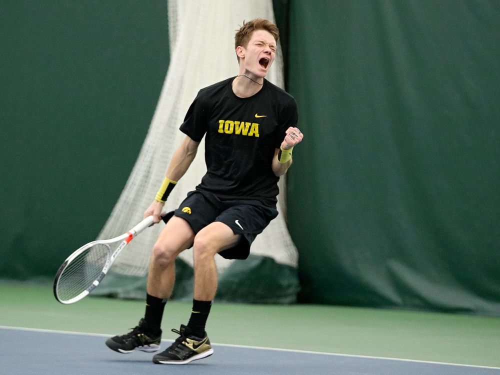 Iowa's Jason Kerst celebrates a point during his match against Marquette at the Hawkeye Tennis and Recreation Complex in Iowa City on Saturday, January 25, 2020. (Stephen Mally/hawkeyesports.com)