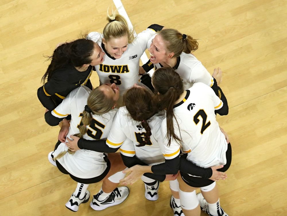 Iowa's Halle Johnston (from left), Maddie Slagle (15), Kyndra Hansen (8), Emma Lowes (6), Courtney Buzzerio (2), and Hannah Clayton (18) celebrate a score during the third set of their match at Carver-Hawkeye Arena in Iowa City on Saturday, Nov 30, 2019. (Stephen Mally/hawkeyesports.com)