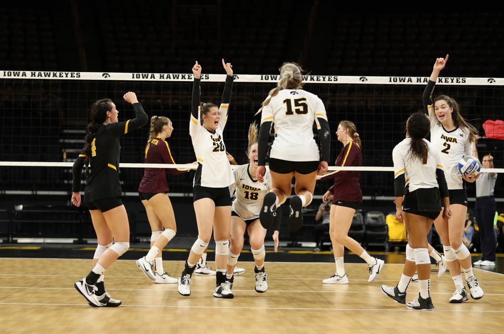 Iowa Hawkeyes outside hitter Edina Schmidt (20) and setter Courtney Buzzerio (2) against the Minnesota Golden Gophers Wednesday, October 2, 2019 at Carver-Hawkeye Arena. (Brian Ray/hawkeyesports.com)