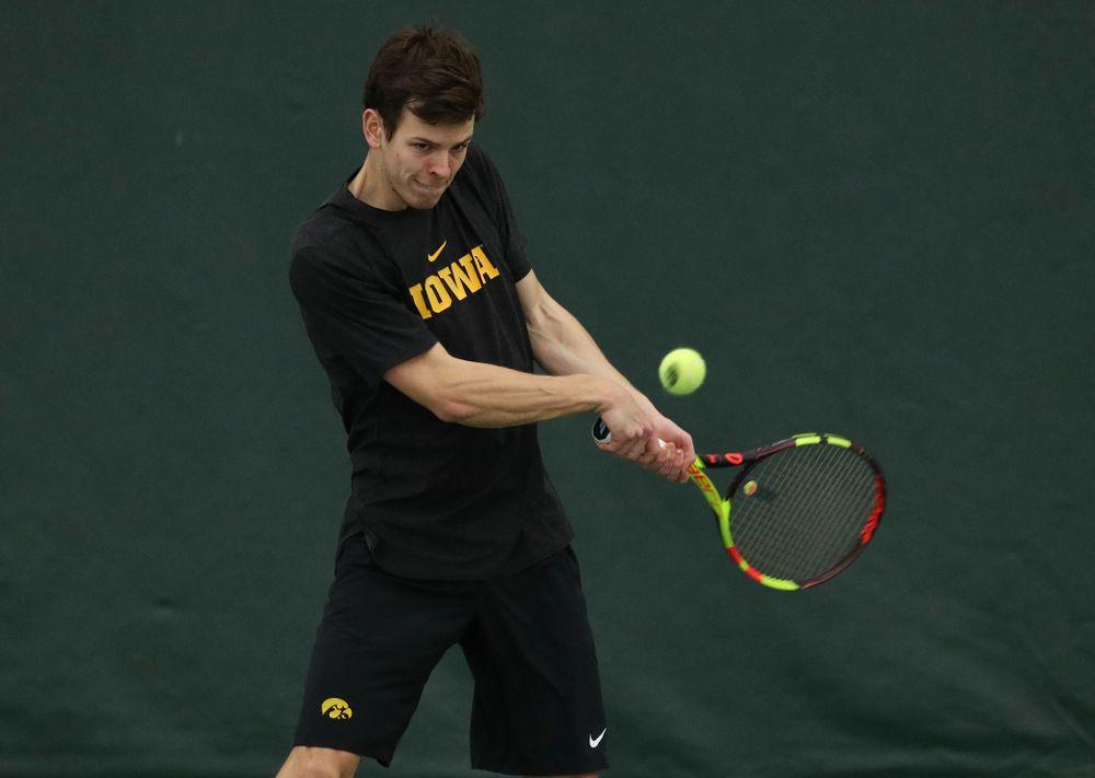 Iowa's Piotr Smietana against UMKC Friday, February 15, 2019 at the Hawkeye Tennis and Recreation Complex. (Brian Ray/hawkeyesports.com)
