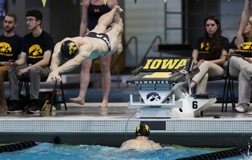 Iowa's Michal Brzus competes in the 400-yard medley relay during a meet against Michigan and Denver at the Campus Recreation and Wellness Center on November 3, 2018. (Tork Mason/hawkeyesports.com)