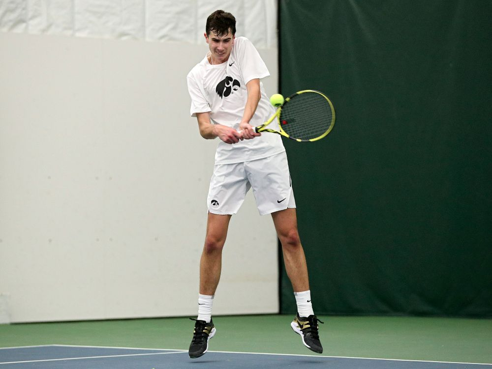 Iowa's Matt Clegg returns a shot during his doubles match at the Hawkeye Tennis and Recreation Complex in Iowa City on Sunday, February 16, 2020. (Stephen Mally/hawkeyesports.com)