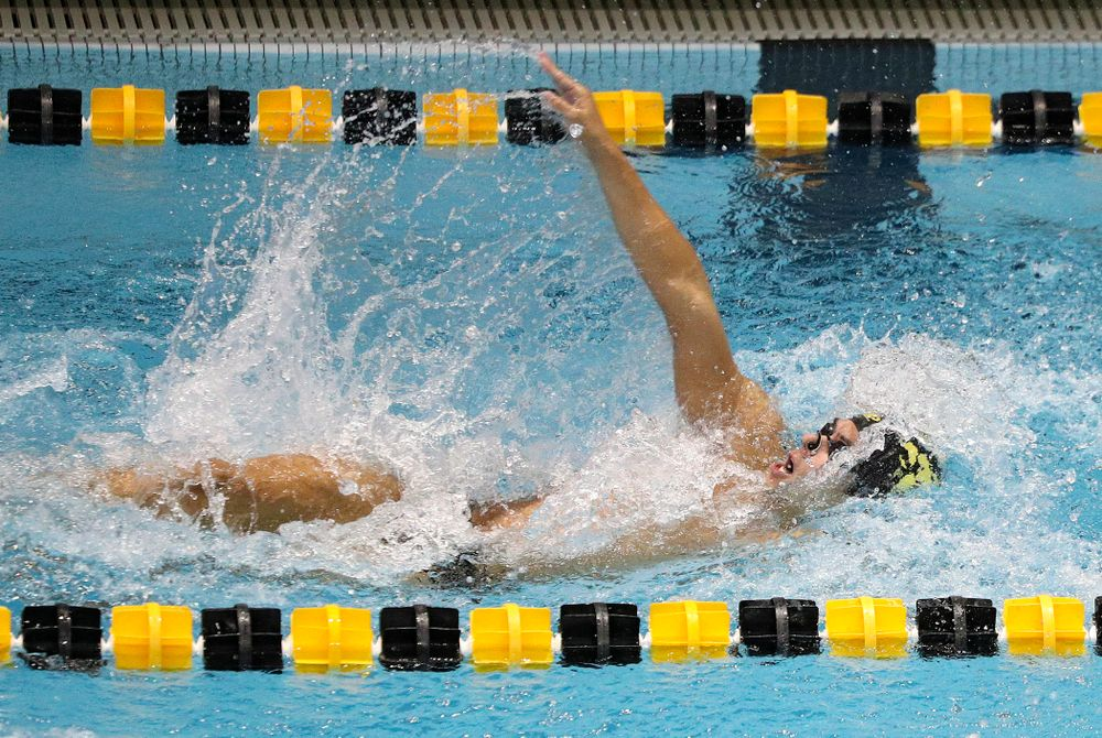Iowa's Preston Planells swims the men's 100-yard backstroke event during their meet against Michigan State and Northern Iowa at the Campus Recreation and Wellness Center in Iowa City on Friday, Oct 4, 2019. (Stephen Mally/hawkeyesports.com)