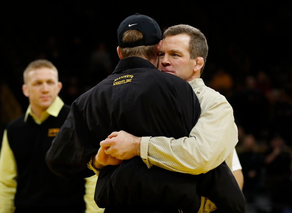 Iowa's senior Brandon Sorensen hugs associate head coach Terry Brands following their meet against Northwestern