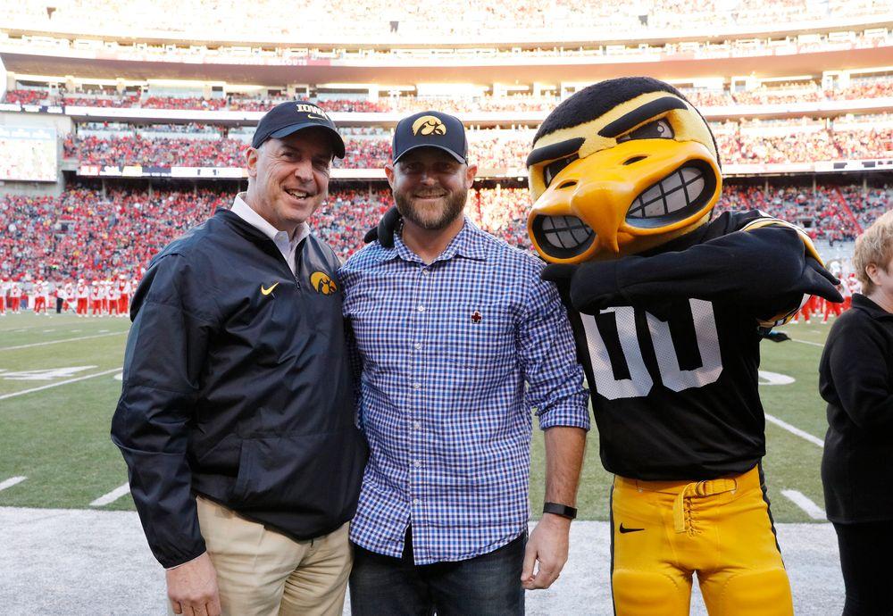 Iowa Hawkeyes Athletics Director Gary Barta and Iowa Citizen Hero Jerry Goeders