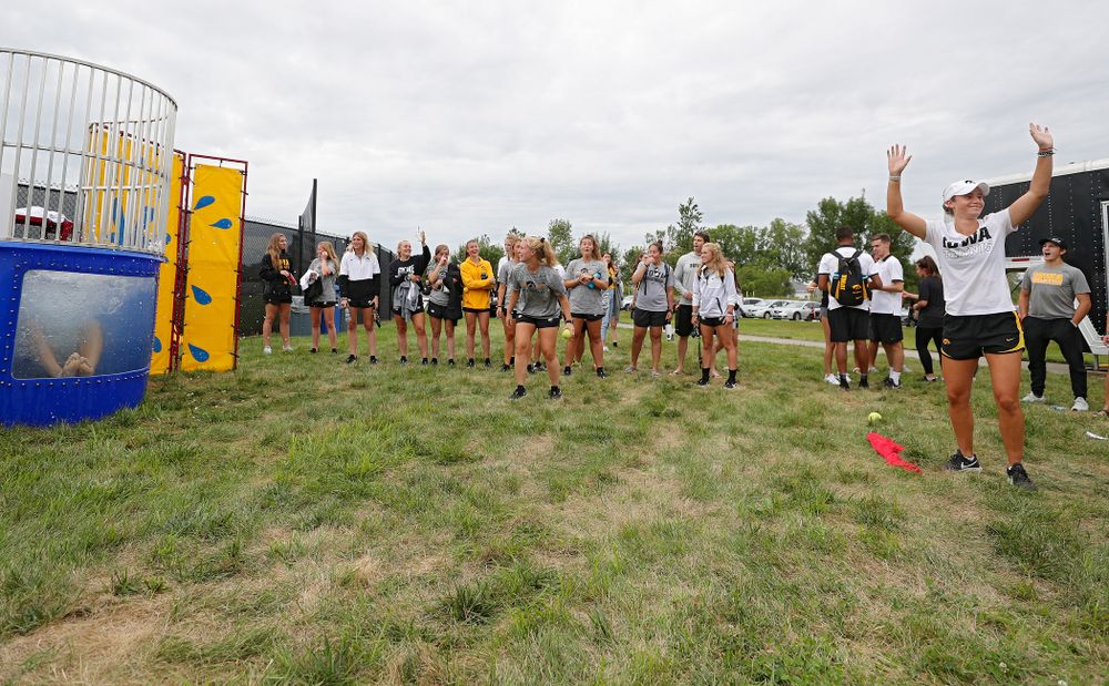 Iowa Women's Tennis' Elise van Heuvelen Treadwell reacts after sinking Women's Tennis program coordinator Daniel Leitner in the dunk tank during the Student-Athlete Kickoff outside the Karro Athletics Hall of Fame Building in Iowa City on Sunday, Aug 25, 2019. (Stephen Mally/hawkeyesports.com)