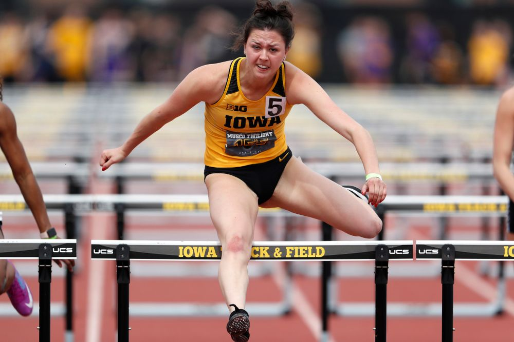 Iowa's Jenny Kimbro competes in the 100 meter hurdles during the 2018 MUSCO Twilight Invitational  Thursday, April 12, 2018 at the Cretzmeye