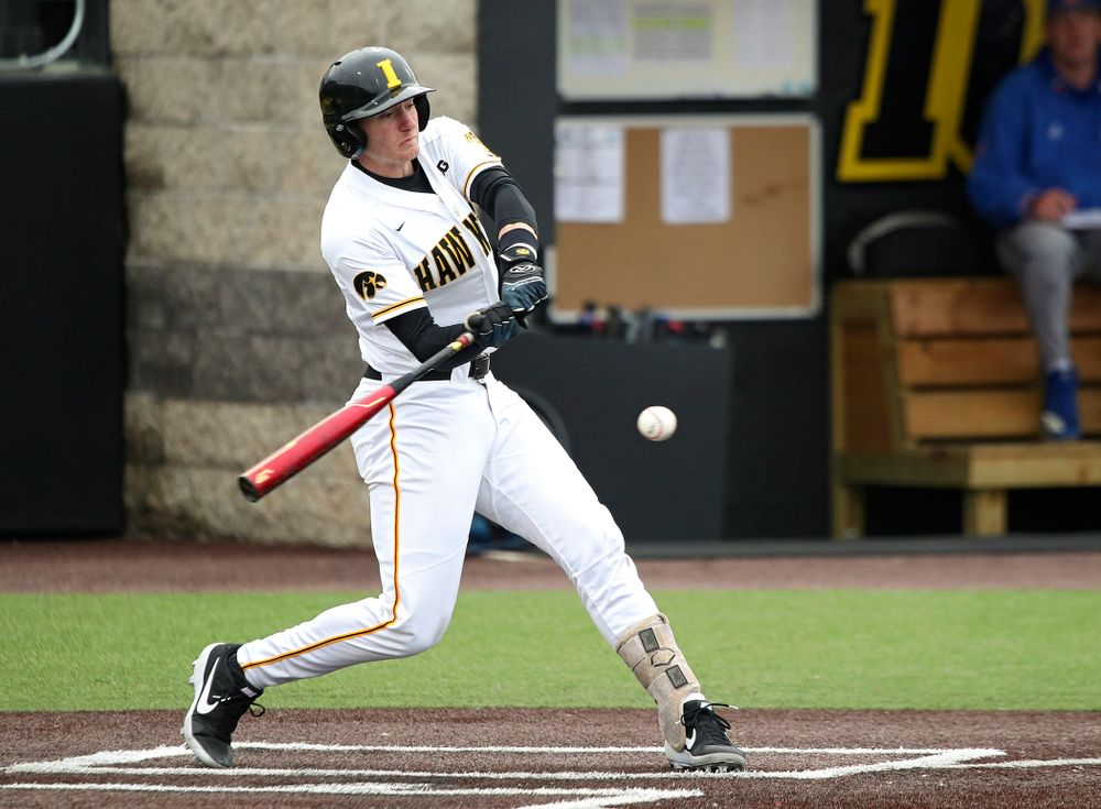 Iowa third baseman Brendan Sher (2) gets a hit during the second inning of their college baseball game at Duane Banks Field in Iowa City on Wednesday, March 11, 2020. (Stephen Mally/hawkeyesports.com)