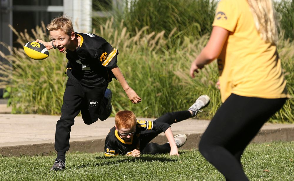 Young fans play a game of touch football before a game against Wisconsin on September 22, 2018.