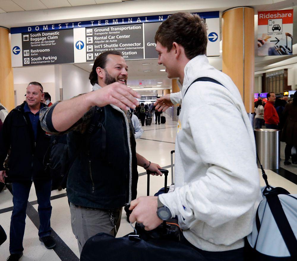 Andy and T.J. Hockenson embrace at the Hartsfield-Jackson Atlanta International Airport.