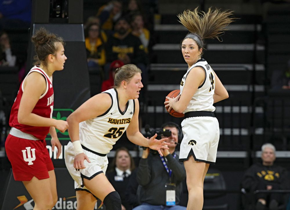 Iowa Hawkeyes guard Mckenna Warnock (14) pulls down a rebound during the second quarter of their game at Carver-Hawkeye Arena in Iowa City on Sunday, January 12, 2020. (Stephen Mally/hawkeyesports.com)