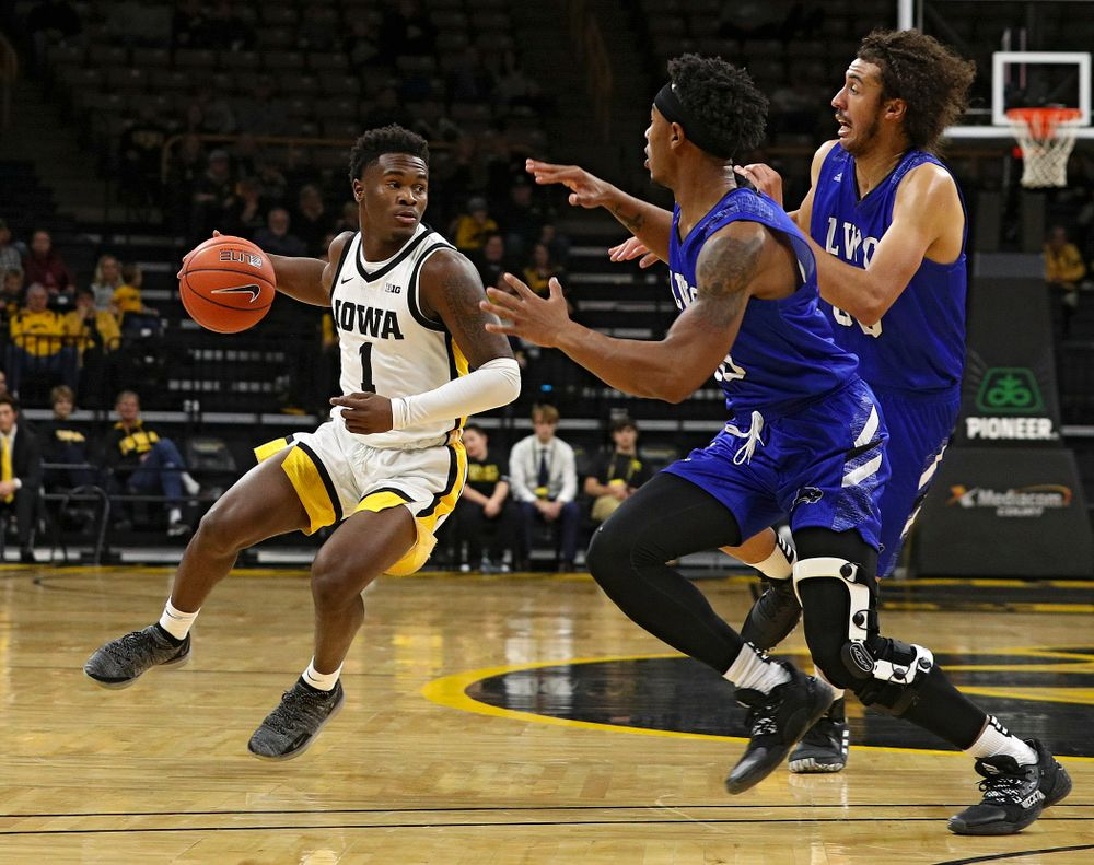 Iowa Hawkeyes guard Joe Toussaint (1) drives with the ball during the first half of their exhibition game against Lindsey Wilson College at Carver-Hawkeye Arena in Iowa City on Monday, Nov 4, 2019. (Stephen Mally/hawkeyesports.com)