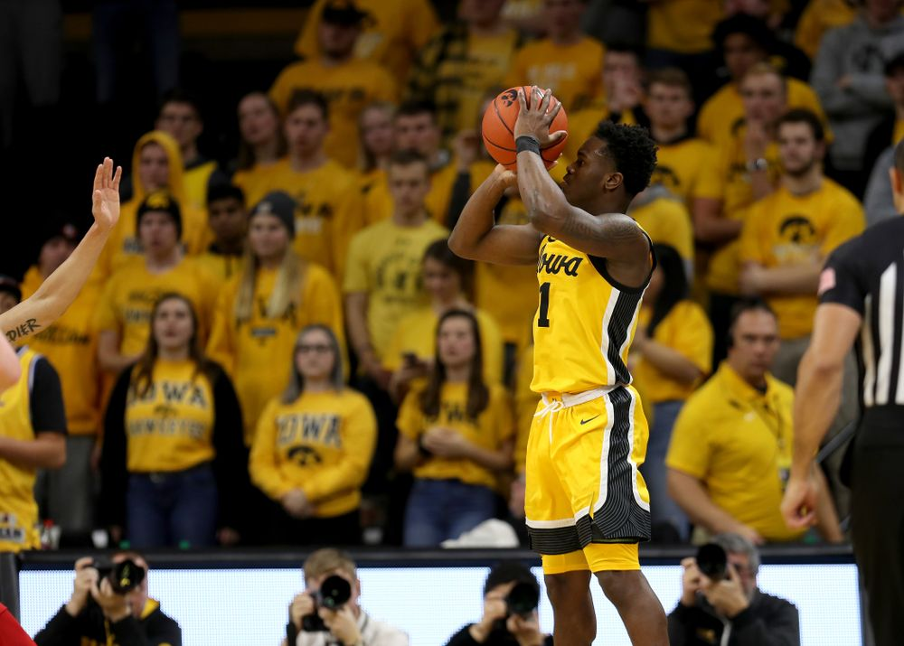 Iowa Hawkeyes guard Joe Toussaint (1) knocks down a three point basket against the Rutgers Scarlet Knights  Wednesday, January 22, 2020 at Carver-Hawkeye Arena. (Brian Ray/hawkeyesports.com)
