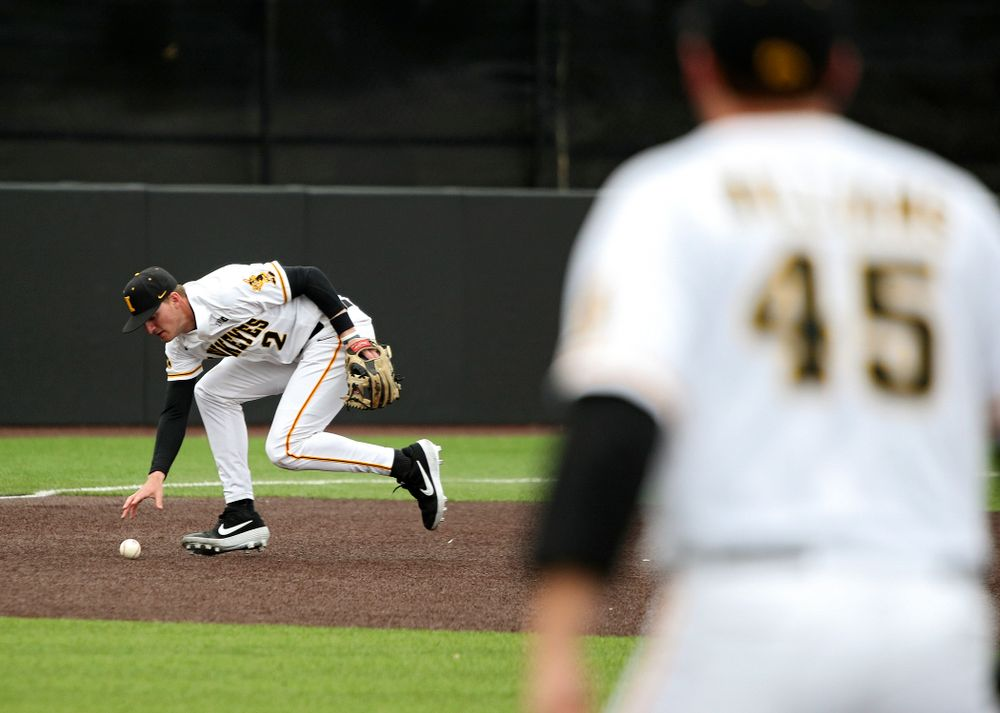 Iowa third baseman Brendan Sher (2) fields a ground ball before throwing to first for an out during the second inning of their college baseball game at Duane Banks Field in Iowa City on Wednesday, March 11, 2020. (Stephen Mally/hawkeyesports.com)