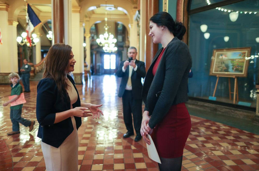 Iowa's Megan Gustafson meets U.S. Representative Abby Finkenauer in the rotunda at the Iowa State Capitol Wednesday, April 24, 2019 in Des Moines. (Brian Ray/hawkeyesports.com)
