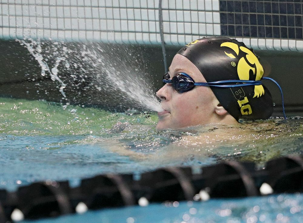 Iowa's Ariel Wooden blows water from her mouth after swimming the 100-yard individual medley event during their meet against Michigan State at the Campus Recreation and Wellness Center in Iowa City on Thursday, Oct 3, 2019. (Stephen Mally/hawkeyesports.com)