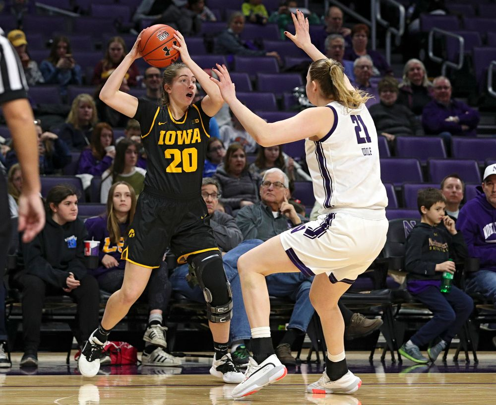 Iowa Hawkeyes guard Kate Martin (20) looks to pass during the fourth quarter of their game at Welsh-Ryan Arena in Evanston, Ill. on Sunday, January 5, 2020. (Stephen Mally/hawkeyesports.com)