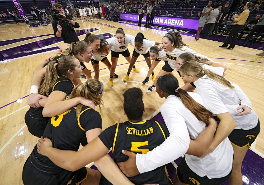 The Hawkeyes huddle before their game at Welsh-Ryan Arena in Evanston, Ill. on Sunday, January 5, 2020. (Stephen Mally/hawkeyesports.com)
