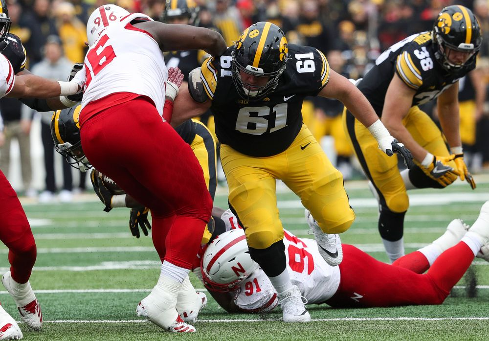 Iowa Hawkeyes offensive lineman Cole Banwart (61) blocks during a game against Nebraska at Kinnick Stadium on November 23, 2018. (Tork Mason/hawkeyesports.com)