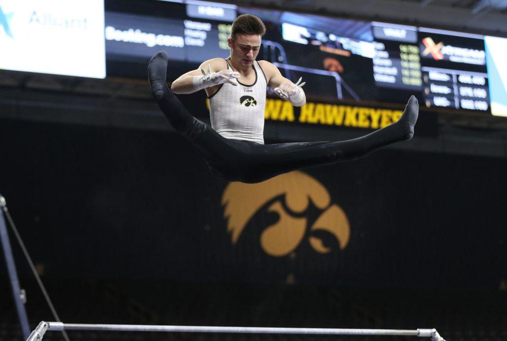 Iowa's Mitch Mandozzi competes on the high bar against UIC and Minnesota Saturday, February 2, 2019 at Carver-Hawkeye Arena. (Brian Ray/hawkeyesports.com)