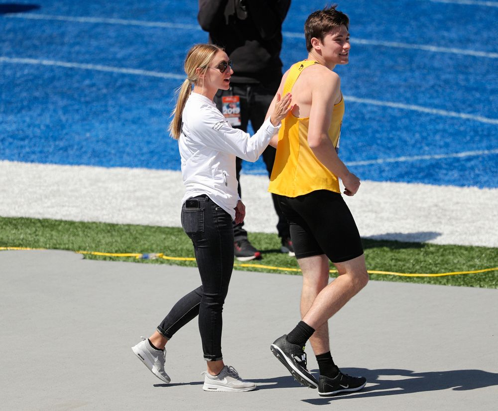 Iowa assistant coach Paige Knodle (from left) talks with Jay Hunt during the men's high jump event during the second day of the Drake Relays at Drake Stadium in Des Moines on Friday, Apr. 26, 2019. (Stephen Mally/hawkeyesports.com)