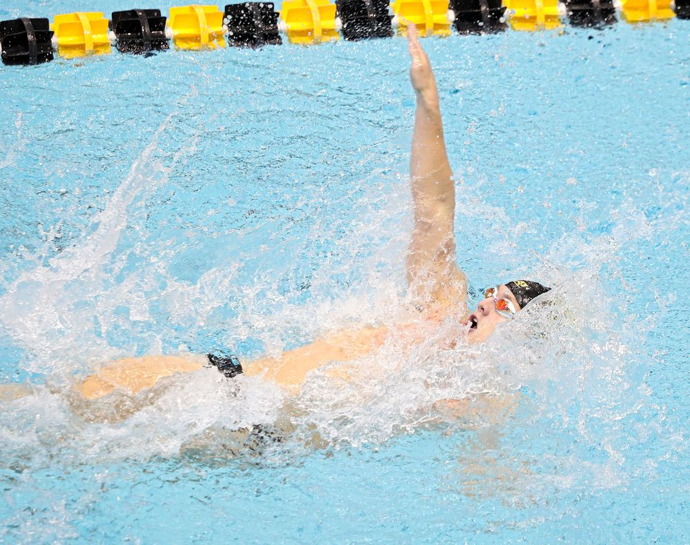 Iowa's Ryan Purdy swims the men's 100-yard backstroke event during their meet against Michigan State and Northern Iowa at the Campus Recreation and Wellness Center in Iowa City on Friday, Oct 4, 2019. (Stephen Mally/hawkeyesports.com)