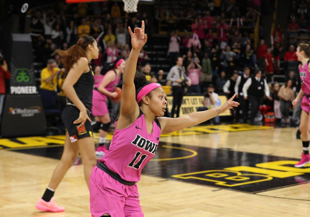 Iowa Hawkeyes guard Tania Davis (11) celebrates their victory against the seventh ranked Maryland Terrapins Sunday, February 17, 2019 at Carver-Hawkeye Arena. (Brian Ray/hawkeyesports.com)