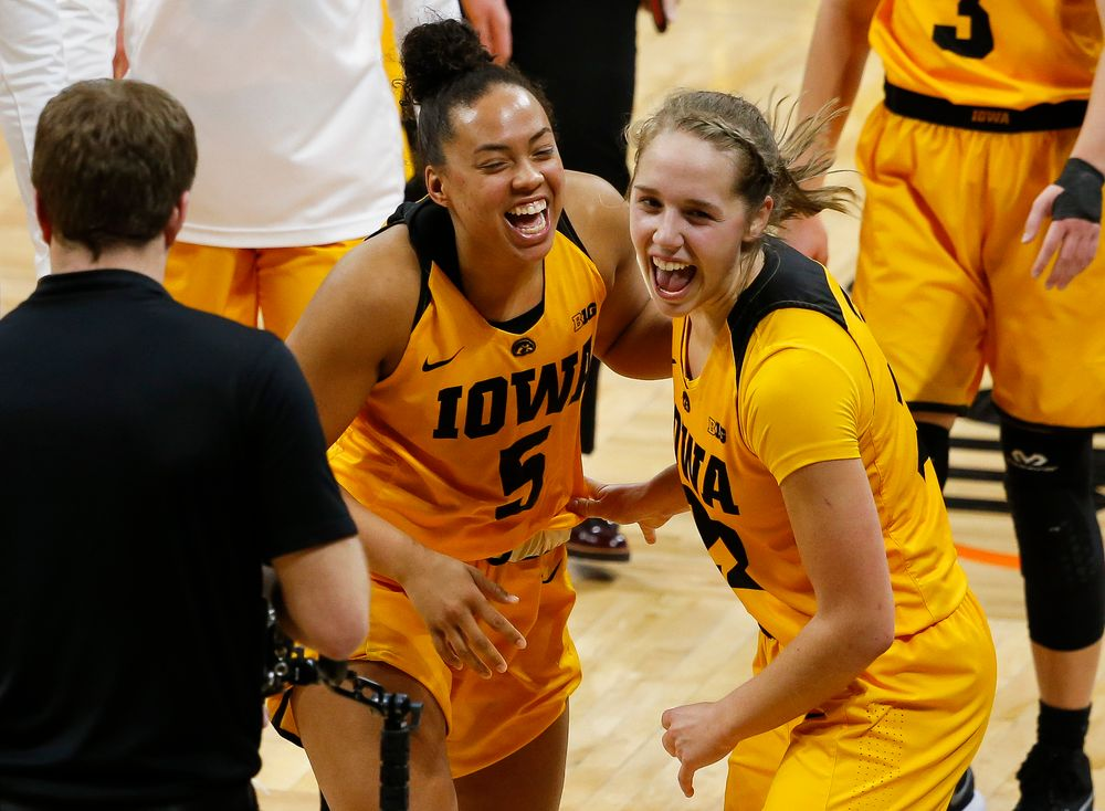 Iowa Hawkeyes guard Alexis Sevillian (5) and Iowa Hawkeyes guard Kathleen Doyle (22) celebrate after a game against the Ohio State Buckeyes at Carver-Hawkeye Arena on January 25, 2018. (Tork Mason/hawkeyesports.com)