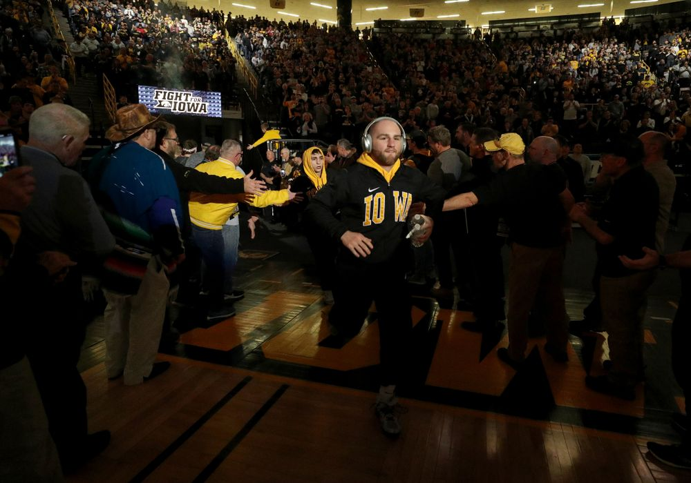 Alex Marinelli runs through the alumni tunnel before the Iowa Hawkeyes meet against Oklahoma State's at pounds Sunday, February 23, 2020 at Carver-Hawkeye Arena. (Brian Ray/hawkeyesports.com)