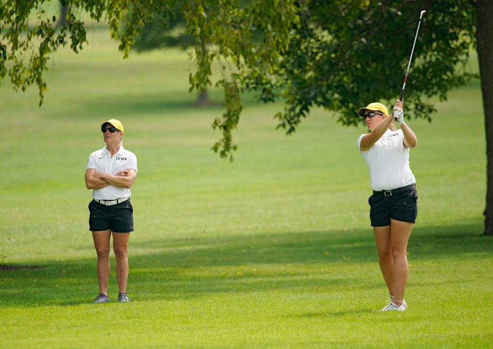 Iowa's Sarah Overton (right) watches her shot as head coach Megan Menzel looks on during their dual against Northern Iowa at Pheasant Ridge Golf Course in Cedar Falls on Monday, Sep 2, 2019. (Stephen Mally/hawkeyesports.com)