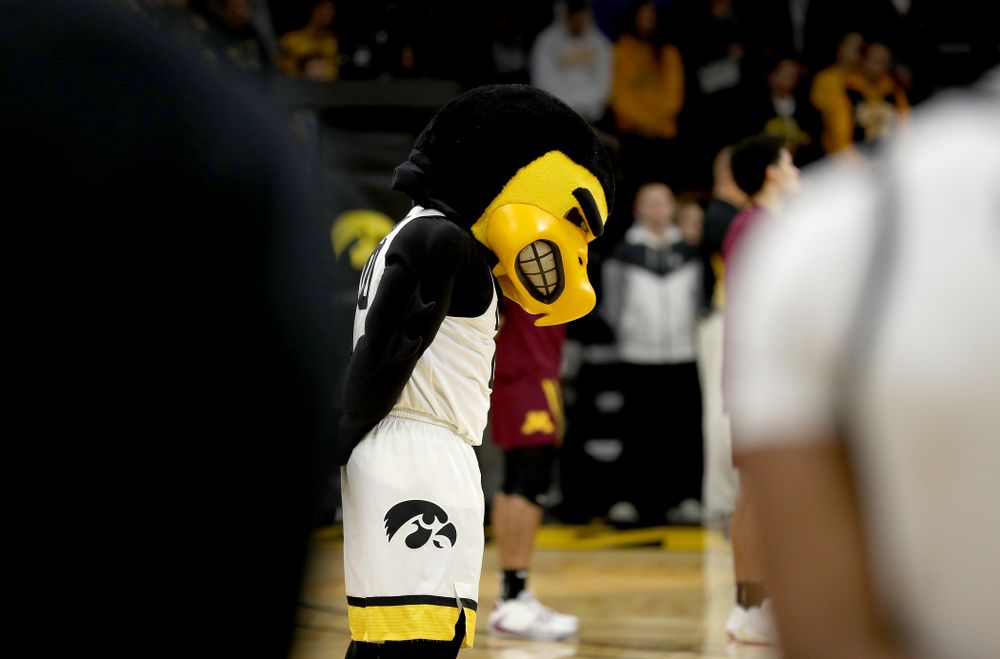 Herky The Hawk bows his head during a moment of silence for former University of Iowa Director of Athletics Bump Elliott before the Iowa Hawkeyes game against the Minnesota Golden Gophers Monday, December 9, 2019 at Carver-Hawkeye Arena. (Brian Ray/hawkeyesports.com)